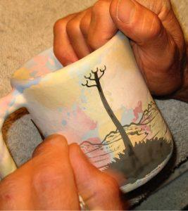 Mana Pottery, painting a mug