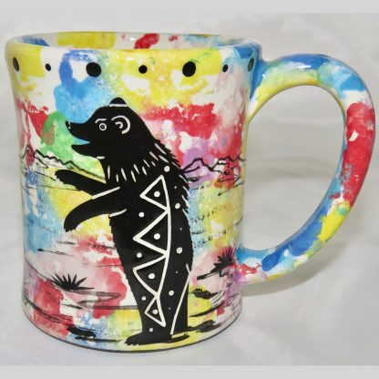 Ear handle mug, standing bear, confetti background.