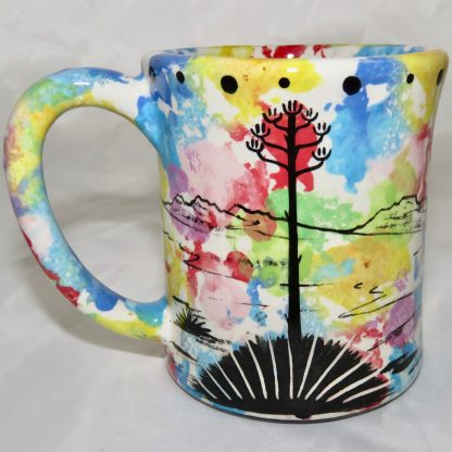 Ear handle mug, standing bear, confetti background. This is the reverse side showing Aravaipa vegetation