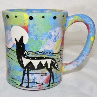 Ear handle mug, howling coyote, blue background.