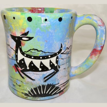 Ear handle mug, jumping deer, blue background.