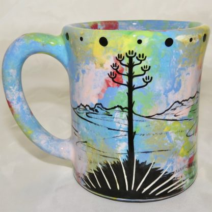 Ear handle mug, jumping deer, blue background. This is the reverse side showing Aravaipa vegetation