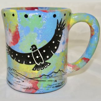 Ear handle mug, hawk with spread wings, blue background.