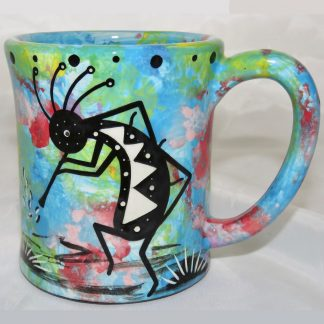 Ear handle mug, kokopelli, turquoise blue background.