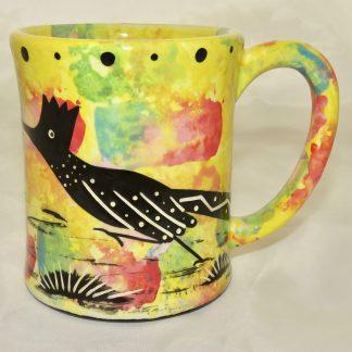 Ear handle mug, running roadrunner, bright yellow background.