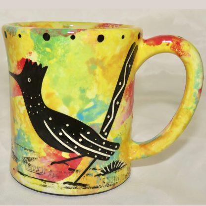 Ear handle mug, standing roadrunner, bright yellow background.