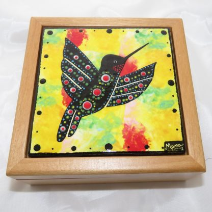 Interior of wood box with hummingbird tile, by Mana Pottery