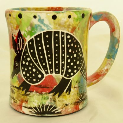Ear-shaped handle mug, armadillo, confetti background.