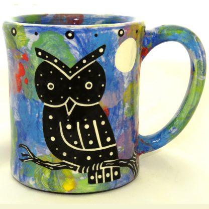Ear-shaped handle mug with owl on blue