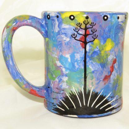 Ear-shaped handle mug with owl on blue - REVERSE, showing Aravaipa vegetation