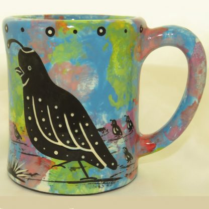 Ear-shaped handle mug with quail on turquoise blue
