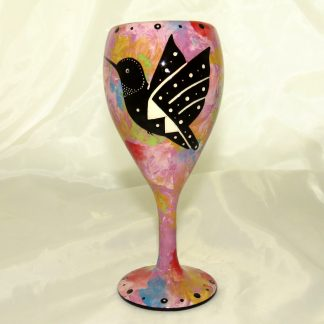 Wine glass with hummingbird on purple