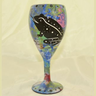 Wine glass with toad on blue