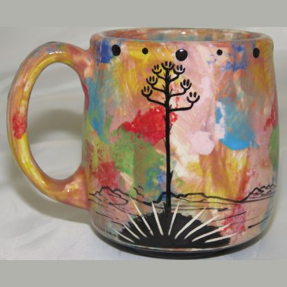 Mana Pottery Country Cup featuring road runner on pink. Image shows reverse side.