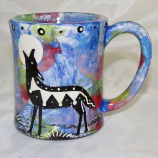 Ear-shaped handle mug with coyote on blue