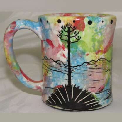 Ear-shaped handle mug with praying woman on confetti. Image shows reverse side.