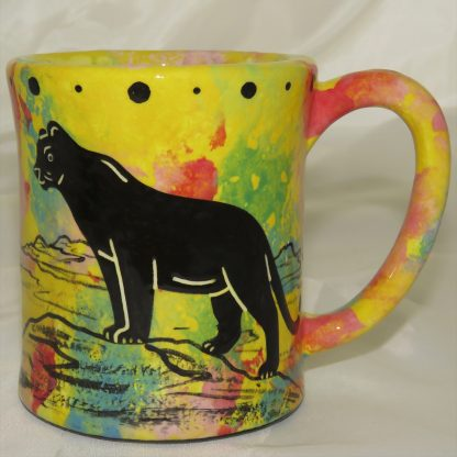 Ear-shaped handle mug with puma lion on bright yellow