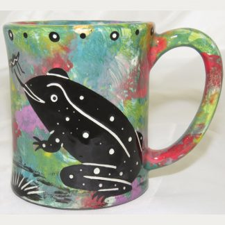 Ear-shaped handle mug with toad on green