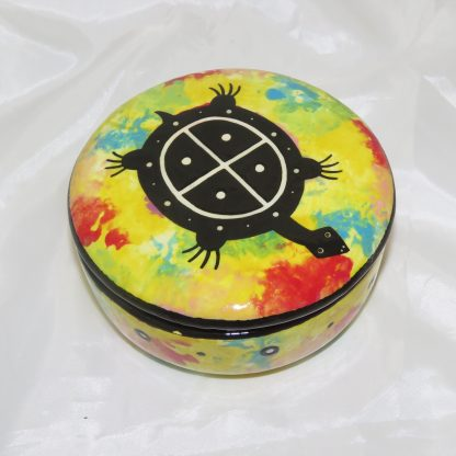 Mana Pottery round clay box featuring turtle on bright yellow