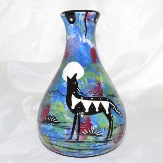 Mana Pottery Teardrop Vase with coyote on one side and native Aravaipa vegetation on reverse.