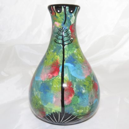 Mana Pottery Teardrop Vase with quail family on one side and native Aravaipa vegetation on reverse, on a background of green. Photo shows reverse side.