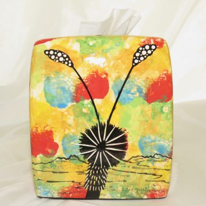 Mana Pottery clay tissue box holder with hummingbird and native Aravaipa vegetation on bright yellow.