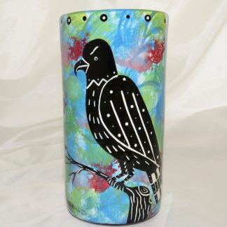 Mana Pottery tall clay tumbler with grey hawk on turquoise blue background.