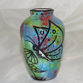"Mana Pottery 5"" vase featuring butterfly and schematic design on reverse, on turquoise blue background."