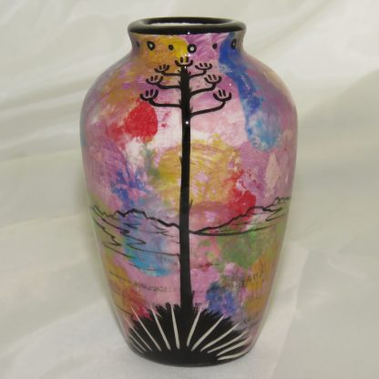 "Mana Pottery 5"" vase with Praying Woman on one side and native Aravaipa vegetation on reverse, on purple background."