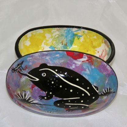 Mana Pottery oval box with toad on purple on outside and confetti interior.