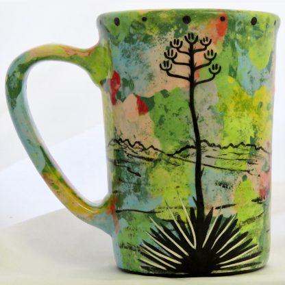 Mana Pottery large mug with praying woman on green. Reverse side shows Aravaipa desert vegetation.