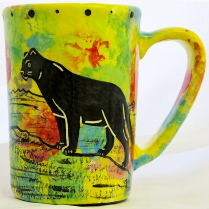 Mana Pottery large mug with puma lion on bright yellow.