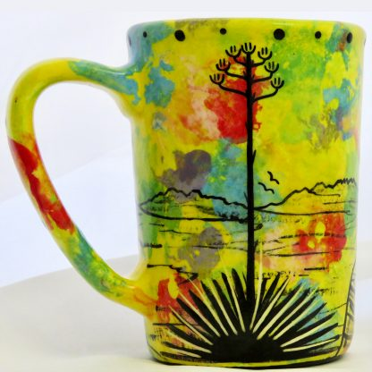 Mana Pottery large mug with puma lion on bright yellow. Reverse shows Aravaipa desert vegetation.