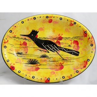 Mana Pottery oval tray with roadrunner on bright yellow background.