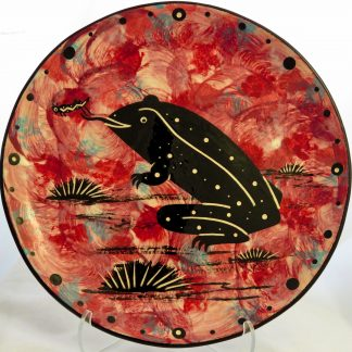 Mana Pottery 10-inch plate with toad on crimson background.