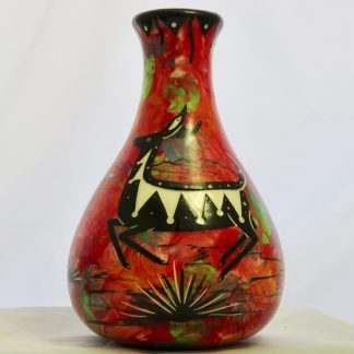 Mana Pottery Teardrop Vase with jumping deer on one side and native Aravaipa desert vegetation on reverse, on a background of crimson.