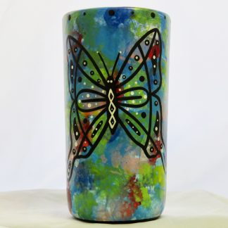 Mana Pottery butterfly tumbler on blue