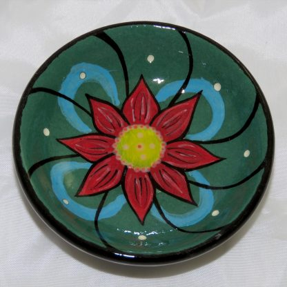 """Mana Pottery tea bag holder featuring green peyote button. 3"""" in diameter and 1"""" high."""