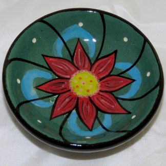 "Mana Pottery tea bag holder featuring green peyote button. 3"" in diameter and 1"" high."