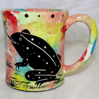Mana Pottery e-mug featuring toad on front and native Aravaipa vegetation on reverse, on confetti background.