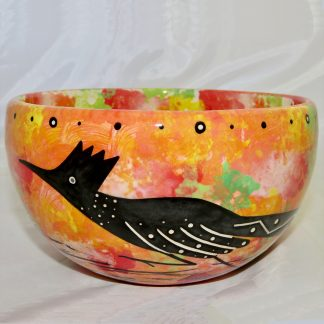 "Mana Pottery extra large soup bowl featuring roadrunner on one side and Aravaipa desert vegetation on reverse. Background and interior are coral. Measures 7"" diameter and 4.5"" in height."