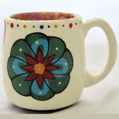 Mana Pottery Country Cup featuring Peyote button on one side and desert vegetation on reverse, on white