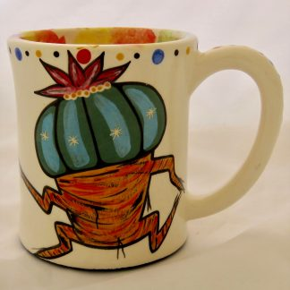 Mana Pottery emug featuring Dancing Peyote on one side and desert vegetation on reverse, on white