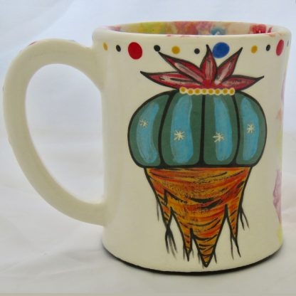 Mana Pottery emug featuring Peyote root on one side and desert vegetation on reverse, on white