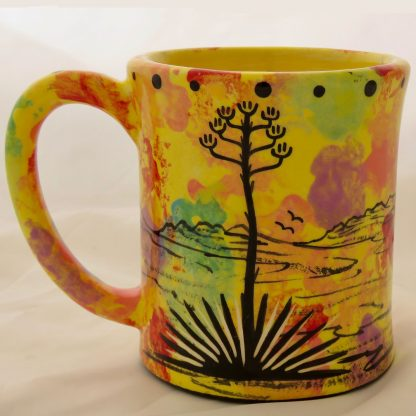 Mana Pottery emug featuring Praying Woman on one side and desert vegetation on reverse, on bright yellow