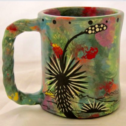 Mana Pottery Rope Mug featuring gecko on one side and desert vegetation on reverse, on green