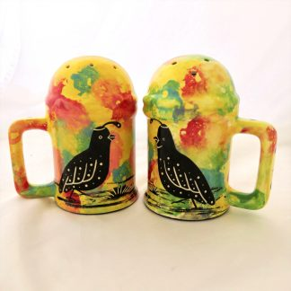 Mana Pottery Salt 'n Pepper Shaker set featuring quail on one side of the shakers and desert vegetation on the reverse.