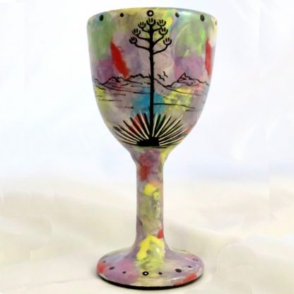 Mana Pottery goblet featuring praying woman on one side and native Aravaipa desert vegetation on reverse, on purple background.