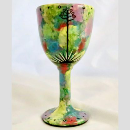Mana Pottery goblet featuring toad on one side and native Aravaipa desert vegetation on reverse, on green background.