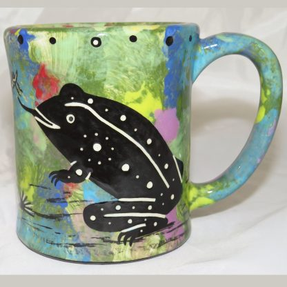 Mana Pottery e-mug featuring toad and desert landscape on reverse sides, on green background.